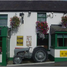 Grey tractor outside pub in Ireland.